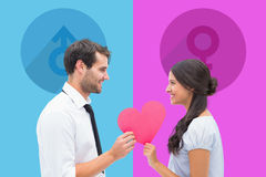 Composite image of pretty brunette giving boyfriend her heart Royalty Free Stock Images