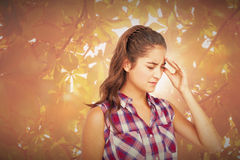 Composite image of a pretty brunette with headache Royalty Free Stock Photography