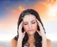 Composite image of pretty brunette with a headache Royalty Free Stock Image