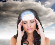 Composite image of pretty brunette with a headache Stock Photo