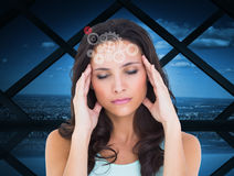 Composite image of pretty brunette with a headache Royalty Free Stock Images