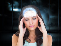 Composite image of pretty brunette with a headache Stock Image