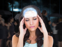 Composite image of pretty brunette with a headache Royalty Free Stock Photography