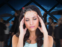 Composite image of pretty brunette with a headache Stock Images