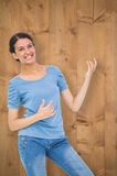 Composite image of pretty brunette playing air guitar Stock Photography