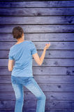 Composite image of pretty brunette playing air guitar Stock Photo