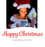 Composite image of pretty brunette in santa outfit opening gift Royalty Free Stock Photography