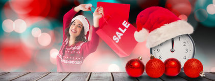 Composite image of pretty brunette showing sale bag and shopping bag Stock Photos