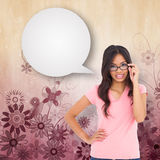 Composite image of pretty brunette thinking with speech bubble Royalty Free Stock Image