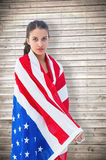 Composite image of pretty brunette wearing the american flag Royalty Free Stock Image