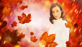 Composite image of pretty brunette in white jumper posing Stock Images