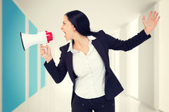 Composite image of pretty businesswoman shouting with megaphone Stock Images