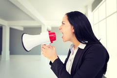 Composite image of pretty businesswoman shouting with megaphone Stock Image