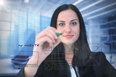 Composite image of pretty businesswoman writing with marker stock image
