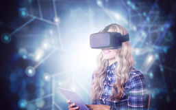 Composite image of pretty casual worker using oculus rift. Pretty casual worker using oculus rift against black background with glowing network Royalty Free Stock Photo