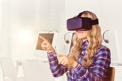 Composite image of pretty casual worker using oculus rift Stock Images