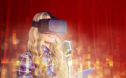 Composite image of pretty casual worker using oculus rift Royalty Free Stock Photography