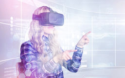Composite image of pretty casual worker using oculus rift. Pretty casual worker using oculus rift against futuristic technology interface Royalty Free Stock Image