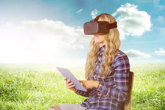 Composite image of pretty casual worker using oculus rift Stock Photo