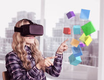 Composite image of pretty casual worker using oculus rift. Pretty casual worker using oculus rift against view of a city Royalty Free Stock Photo