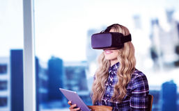 Composite image of pretty casual worker using oculus rift. Pretty casual worker using oculus rift against view of a city Stock Photos