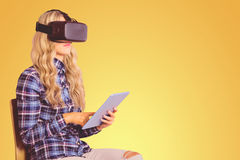 Composite image of pretty casual worker using oculus rift Royalty Free Stock Images