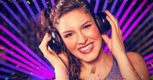 Composite image of pretty female dj playing music Stock Photos