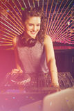 Composite image of pretty female dj playing music Stock Image