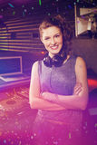 Composite image of pretty female dj standing with arms crossed Royalty Free Stock Photos