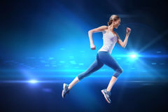 Composite image of pretty fit blonde jogging Royalty Free Stock Image