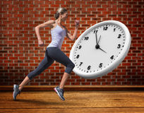 A Composite image of pretty fit blonde jogging stock image