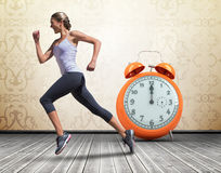 A Composite image of pretty fit blonde jogging stock photo