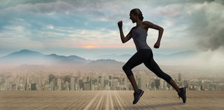 A Composite image of pretty fit blonde jogging royalty free stock photos