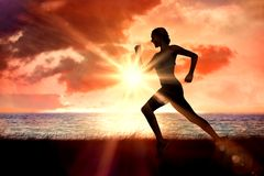 Composite image of pretty fit blonde jogging Royalty Free Stock Photo
