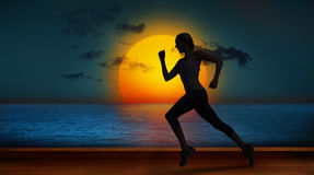 A Composite image of pretty fit blonde jogging royalty free stock image
