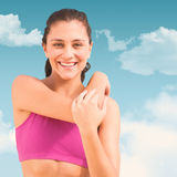 Composite image of pretty fit woman stock photography