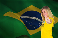 Composite image of pretty football fan in brasil tshirt Royalty Free Stock Images