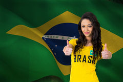 Composite image of pretty football fan in brasil tshirt Stock Images