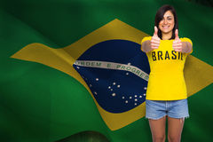 Composite image of pretty football fan in brasil tshirt Royalty Free Stock Photo