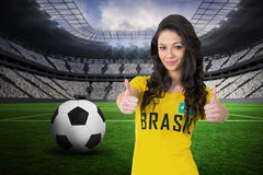 Composite image of pretty football fan in brasil tshirt Royalty Free Stock Photos
