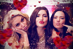 Composite image of pretty friends. Pretty friends  against hearts background Royalty Free Stock Photography