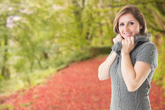 Composite image of pretty girl in jumper Royalty Free Stock Photos