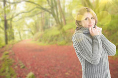 Composite image of pretty girl in jumper Stock Photo
