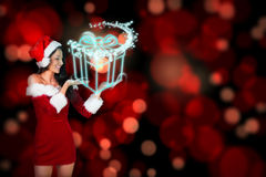 Composite image of pretty girl presenting in santa outfit Royalty Free Stock Image