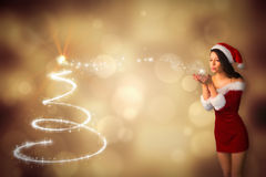 Composite image of pretty girl in santa outfit blowing Stock Images