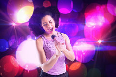 Composite image of pretty girl singing Royalty Free Stock Image