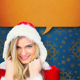 Composite image of pretty girl smiling in santa outfit Royalty Free Stock Images