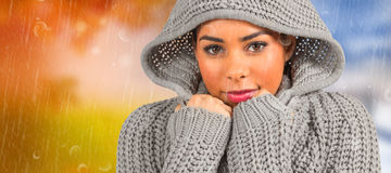 Composite image of pretty girl in winter jumper looking at camera Stock Photography