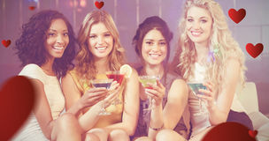 Composite image of pretty girls with cocktails Stock Image