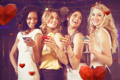 Composite image of pretty girls with cocktails Royalty Free Stock Photo